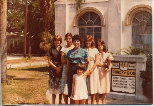 Mom and her daughters, visiting my maternal grandparents' church, 1982.