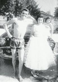 Mom, in her prom dress, standing next to her brother Bud.