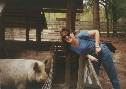 Visiting a hog at a Gainesville farm while in law school.